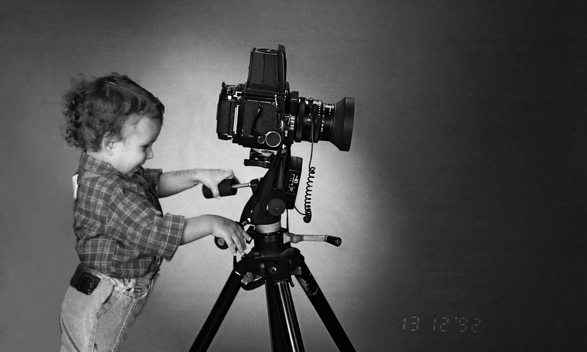 young boy and a camera